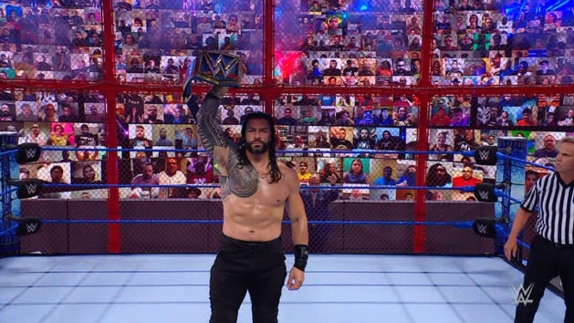WWE - Roman Reigns Holds Universal Title Up Inside Hell in a Cell